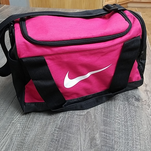 1d28b342a2 Nike Just Do It Pink Small Duffel Bag. M 5bd6a134bb76153e2a37c616